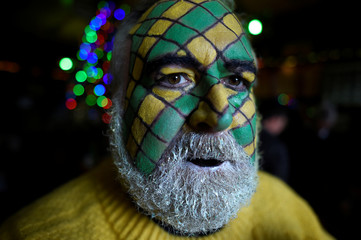 Trevis Gleason poses for a photograph during an Irish tradition of Hunting of the Wren festival held every St. Stephen's Day in Dingle