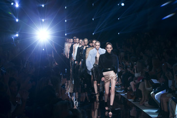 Models present creations by French designer Vauthier as part of his Haute Couture Fall Winter 2013/2014 fashion show in Paris