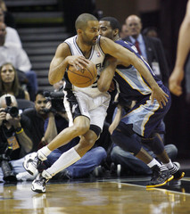 San Antonio Spurs Tony Parker drives against Memphis Grizzlies Zydrunas Ilgauskas during the first half of Round 1 of the Western Conference NBA basketball playoffs in San Antonio