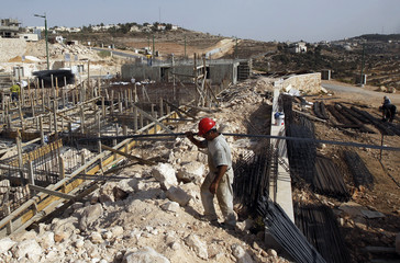 A Palestinian labourer works on a construction site in the West Bank Jewish settlement of Har Gilo near Jerusalem