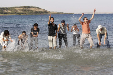 A group of activists from Raqqa cool off during an excursion to the Euphrates river in al-Tabaqa