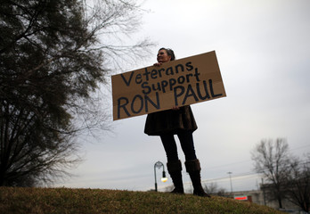 A woman holds a sign in support of Republican presidential candidate and U.S. Representative Ron Paul (R-TX) in Columbia