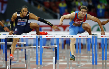 Shubenkov of Russia and Martinot-Lagarde of France compete in the men's 110 metres hurdles final during the European Athletics Championships at the Letzigrund Stadium in Zurich