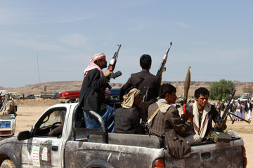 Members of the Houthi movement patrol an area near a tribal gathering held to show support to the movement in the northern city of Saada, Yemen
