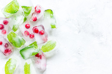 fresh cranberry in ice cubes on gray stone background top view mock-up