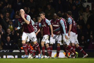 West Ham United's James Collins celebrates after scoring his second goal against Manchester United during  their FA Cup third round soccer match in London