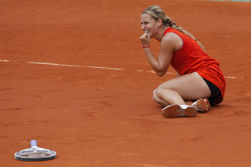 Cibulkova of Slovakia reacts after winning her match against Azarenka of Belarus during the French Open tennis tournament at the Roland Garros stadium in Paris