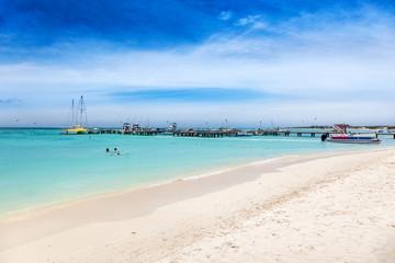 Fishing boats moored at the docks on Palm Beach, Aruba