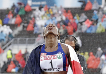 Nana Djimou of France reacts after winning the women's heptathlon at the European Athletics Championships in Helsinki
