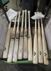 Louisville Slugger bats with World Series logos are seen in Louisville
