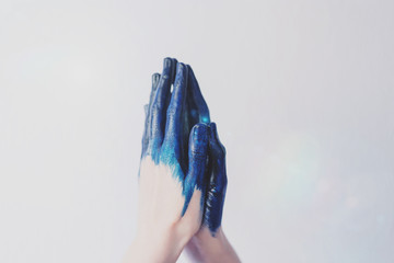 Painted blue hands