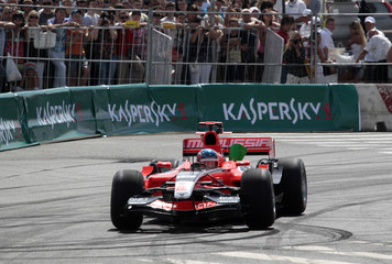 The Marussia team Formula One car piloted by Charles Pic drives during the Moscow City Racing event in Moscow