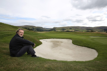 Head greenkeeper on the PGA centenary course Chappell poses for a photograph next to a bunker at Gleneagles in Perthshire