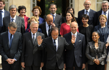 France's President Francois Hollande poses for the traditional family photo of the government at the Elysee Palace in Paris