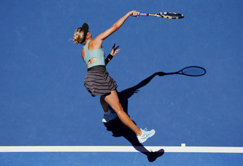 Eugenie Bouchard of Canada serves to Ana Ivanovic of Serbia during their women's quarter-final tennis match at the Australian Open 2014 tennis tournament in Melbourne