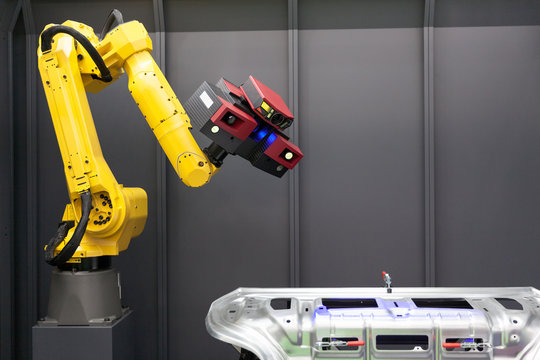 Automated scanning. 3D scanner mounted on robotic arm.