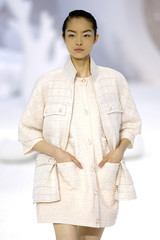 A model presents a creation by designer Lagerfeld as part of his Spring/Summer 2012 collection for Chanel during a fashion show in Paris