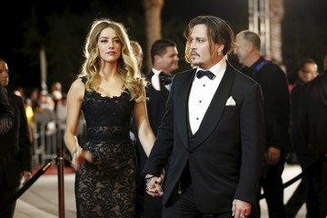 File photo of Desert Palm Achievement Award recipient actor Johnny Depp and wife actress Amber Heard posing at the 27th Annual Palm Springs International Film Festival Awards Gala in Palm Springs