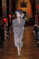 A model presents a creation by British designer Vivienne Westwood as part of her Spring/Summer 2013 women's ready-to-wear fashion show during Paris fashion week
