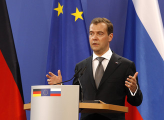Russian President Medvedev speaks to reporters during a news conference with German Chancellor Merkel following consulations in Hanover