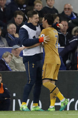 Tottenham's Son Heung-min celebrates scoring their fourth goal with Kevin Wimmer