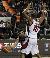 Uruguay's Batista passes the ball under pressure from Panama's Garces during their first round basketball game of the FIBA Americas Championship in Mar del Plata