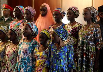 Some of the 21 Chibok schoolgirls released by Boko Haram look on during their visit to meet President Muhammadu Buhari In Abuja, Nigeria