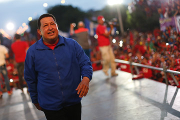 Venezuela's President and presidential candidate Hugo Chavez walks on the stage during a campaign rally in Barquisimeto