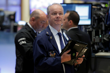 Traders work on the floor of the New York Stock Exchange in New York City