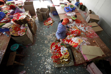 Employees work at a Chinese new year merchandising factory in Yiwu, Zhejiang province