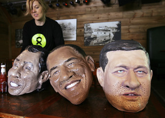 An Oxfam activist prepares the heads of G8 leaders before a photo opportunity ahead of the G8/G20 summits in Huntsville