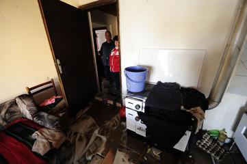 Woman walks through her flooded home to salvage belongings in Sveti Nikole