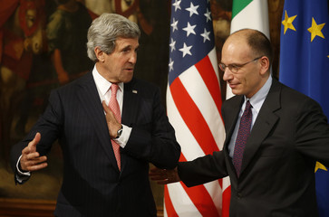 Italy's Prime Minister Enrico Letta talks with U.S. Secretary of State John Kerry during a meeting at Chigi Palace in Rome