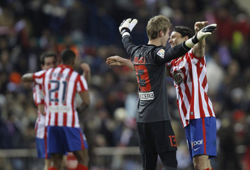 Atletico Madrid's Ujfalusi and De Gea celebrate after their Spanish first division match against Barcelona in Madrid