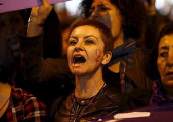 Activists take part in a rally to mark International Women's Day in central Istanbul
