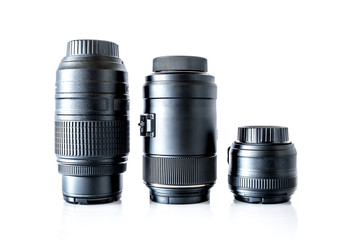 Lenses to a SLR camera close-up with reflection isolated on a white background