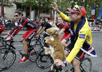 BMC Racing Team's Cadel Evans of Australia celebrates on the Champs Elysees after winning the 98th Tour de France cycling race