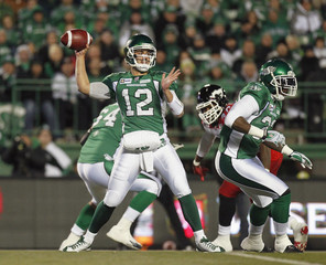 Saskatchewan Roughriders Tino Sunseri looks to make the pass while playing against Calgary Stampeders during first half CFL game in Regina