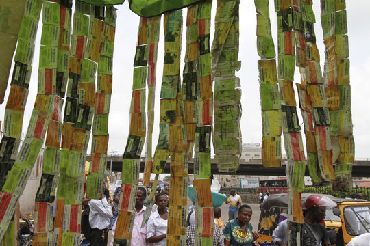 Used mobile telephone cards are stringed together at a roadside call centre in Obalende district in Nigeria's commercial capital Lagos