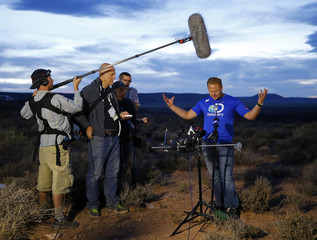 Daredevil Wallenda gestures during a news conference after completing a high-wire walk across more than a quarter-mile deep remote section of the Grand Canyon near Little Colorado River