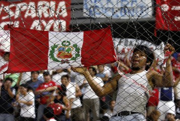 A fan of Peru's Juan Aurich soccer club cheers for his team before the Copa Libertadores match against Argentina's Estudiantes LP in Buenos Aires