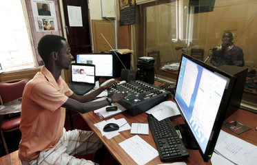 Senior staff at Radio Publique Africaine work inside their broadcasting studio in the capital Bujumbura