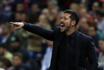 Atletico Madrid's coach Simeone gives instructions during their Champions League group C soccer match against Astana in Madrid