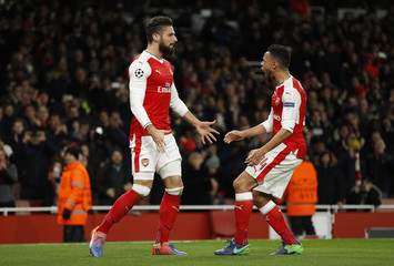 Arsenal's Olivier Giroud celebrates scoring their first goal with Francis Coquelin