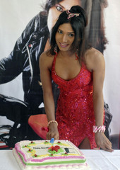 India's first transgender television show host, 30-year-old Rose Venkatesan, cuts her birthday cake after a news conference in Chennai