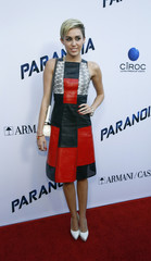 "Cyrus poses at premiere of ""Paranoia"" in Los Angeles"