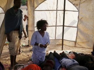 Garissa University students wait at a temporary shelter as they wait for relocation after Thursday's attack by gunmen in their campus, in Garissa