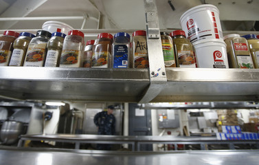 Jars of herbs and spices are stacked in the galley where food is cooked during a tour of the USS John C. Stennis