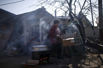 A woman cooks at a border village just south of the demilitarized zone where loudspeakers are installed, in Yeoncheon