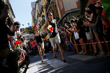 Competitors take part in the annual race on high heels during Gay Pride celebrations in Madrid